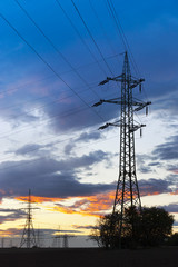 Electricity - Power energy Industry - Electric poles at the sunset with coloful sky