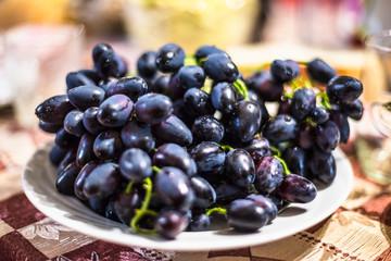 Black grape on a plate
