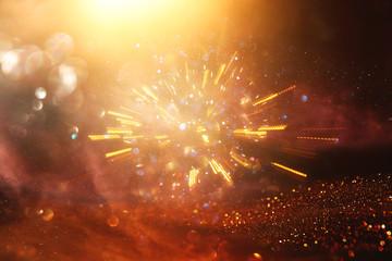 glitter vintage lights background. gold light burst. defocused.