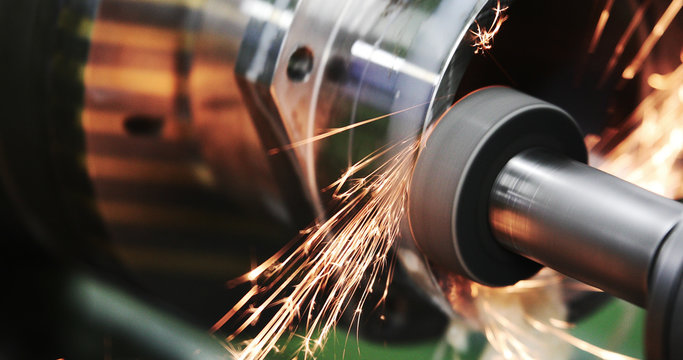Finishing metal working on high precision grinding machine in workshop