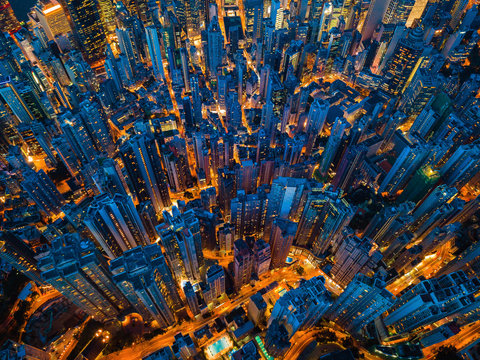 Aerial view of Hong Kong Downtown. Financial district and business centers in smart city, technology concept. Top view of skyscraper and high-rise buildings at night.