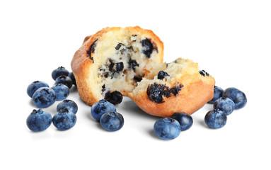 Tasty blueberry muffin on white background