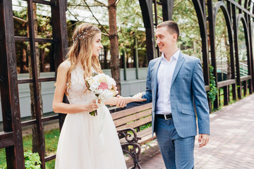 beautiful couple in love on a wedding day in summer sunny day