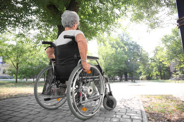 Senior woman in wheelchair outdoors