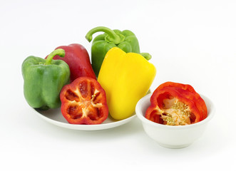 Colorful of sweet pepper and sliced pepper isolated on white background