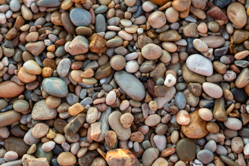 An abstract background of pebbles on the iconic Port Willunga Beach in South Australia on 22nd September 2018