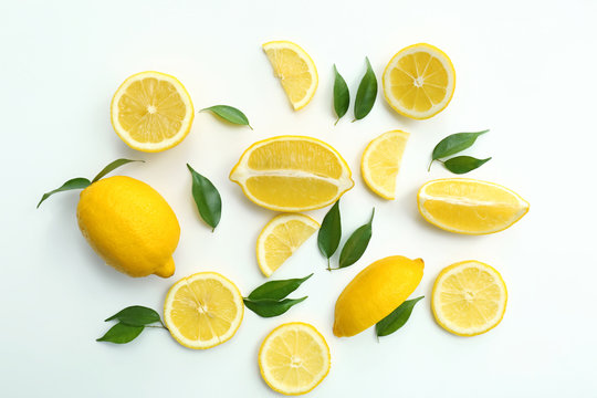Flat lay composition with ripe juicy lemons on white background