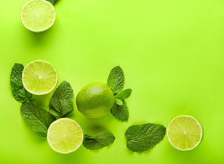 Ripe limes on color background
