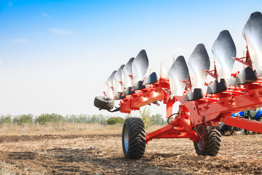 Agricultural plow close-up on the ground