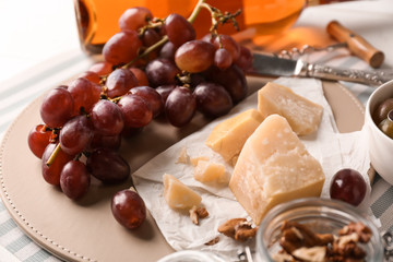 Fresh ripe juicy grapes with cheese on table