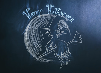 "Drawing of witch with text ""Happy Halloween"" on dark background"
