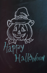 "Drawing of pumpkin with text ""Happy Halloween"" on dark background"