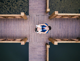Loving couple on the dock at the lake
