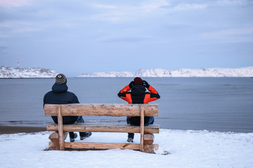 People on the bench in Teriberka, Murmansk Region, Russia