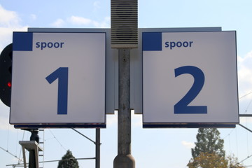 Signs of the platform numbers on station Boskoop in the Netherlands.
