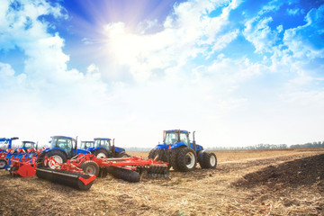 Wall Mural - Modern tractors in the empty field.