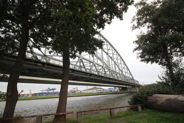 White bridges for trains between Amsterdam and Utrecht named Demkabrug and Werkspoorbrug in Utrecht over the Amsterdam-Rhine canal in the Netherlands