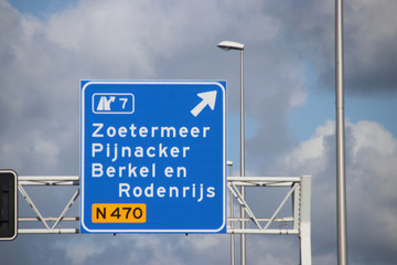 Sign above motorway A12 for the junction to Zoetermeer, Pijnackter and Berkel and Rodenrijs on regional road N470 in the Netherlands.