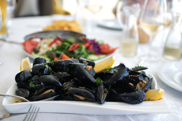 Cooked mussels served on the table with salad. Albania. Adriatic coast. National food