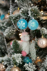Close-up of a branch of a Christmas tree with bright toys.