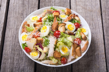 Salad ceasar with chicken , eggs and tomatoes