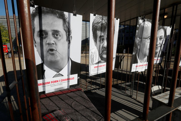 Portraits of Catalonian politicians are seen inside a mock prison cell during a protest in favour of  Catalonia's independence outside the European Commission headquarters in Brussels
