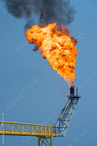 Fire on flare stack at offshore oil and gas central