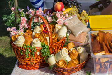 different varieties of Adyghe cheese in baskets and Adyghe garlic salt on the table