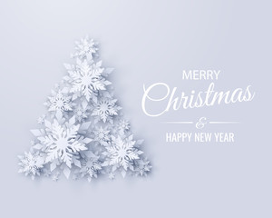 Vector Merry Christmas and Happy New Year greeting card design with Christmas tree made of realistic looking paper cut snowflakes. Seasonal Christmas and New Year holidays paper craft background