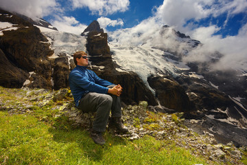 Tourist watching a mountain landscape with glaciers and peaks nearby resort of Kandersteg, Switzerland