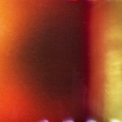 Colorful abstract texture background with grain and light leak
