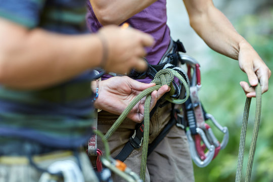 Anonymous rock climbers with gear
