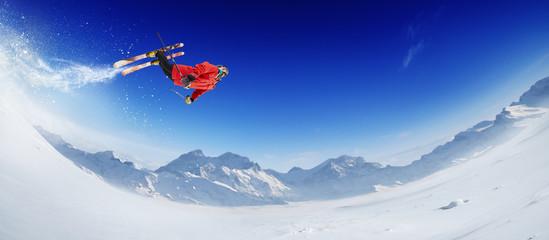 Fototapeta Skiing. Jumping skier. Extreme winter sports. obraz