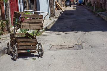 wooden wheelbarrow in the street