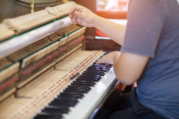 Piano repairers or musicians are repairing and customizing the piano.