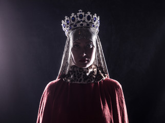 queen with crown, studio portrait on a black background