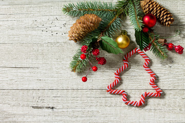 Christmas background. Christmas decoration on a wooden table. Top view with copy space.