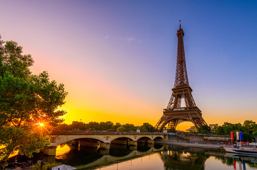 Fotobehang Centraal Europa View of Eiffel Tower and river Seine at sunrise in Paris, France. Eiffel Tower is one of the most iconic landmarks of Paris