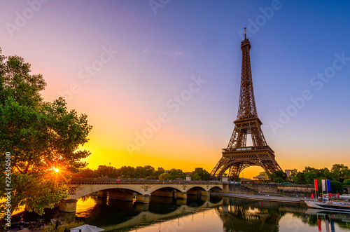 Fotomurales View of Eiffel Tower and river Seine at sunrise in Paris, France. Eiffel Tower is one of the most iconic landmarks of Paris