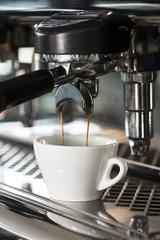 Professional coffee machine is preparing coffee speciality. Closeup.