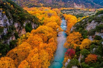 Aluminium Prints Autumn Aerial view of the Old stone bridge in Klidonia Zagoria in the autumn, Epirus, Western Greece.