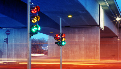 Trafficlights in the city at night time. Urban road view
