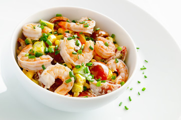 salad with steamed shrimps, cherry tomatoes, corn, and avocado dressed with mayonnaise and decorated with green onion