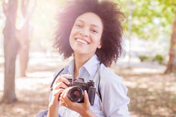 Happy Black Woman With Retro Camera In Nature