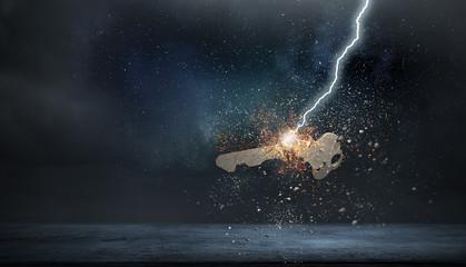Lightning striking key. Mixed media