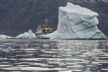 expedition vessel surrounded by massive Icebergs floating in the fjord scoresby sund, east Greenland
