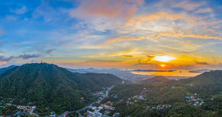 aerial view sunrise in Chalong sea Phuket big Buddha is on the top of Nakkerd mountain.Phuket big Buddha is the famous landmark in Phuket island  a lot of tourists visiting this landmark every day