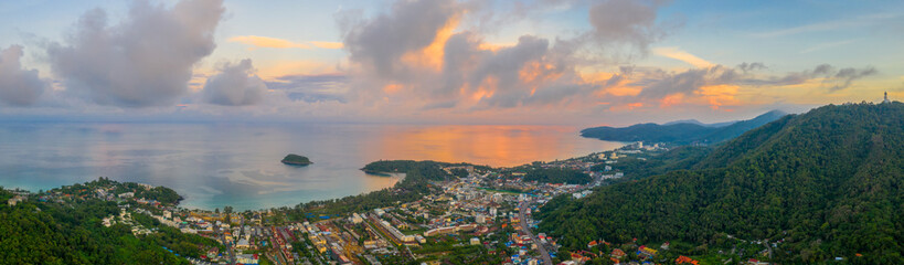 aerial panorama sunrise at Kata beach close to Karon beach in the middle of two beach has Pu island.aerial view sunrise in Chalong sea