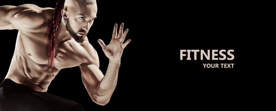 The fit man doing weight lifting in gym on black background. The fitness, training, sport, workout, exercise, athlete, healthy lifestyle concept