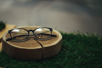 Close up black business glasses isolated on wood table